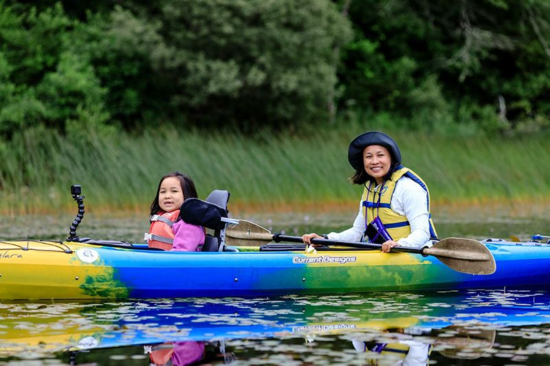 Parent canoeing with their kids - Dream Day on Cape Cod
