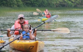 Parents canoeing with their kids - Dream Day on Cape Cod